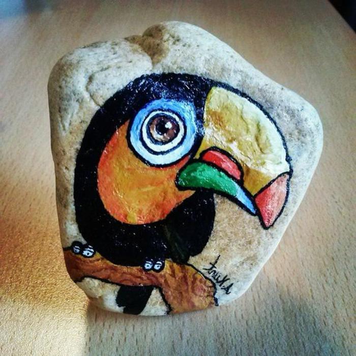 peinture sur galets, perroquet sur un galet