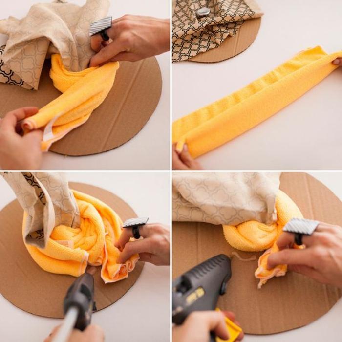 tuto pouf, pistolet à colle forte, serviette jaune, tissu beige à décoration noire