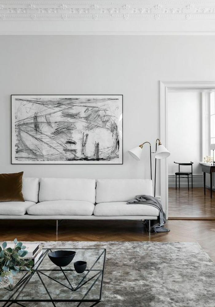 salon minimaliste, sofa blanc, peinture graphique-murs-blancs