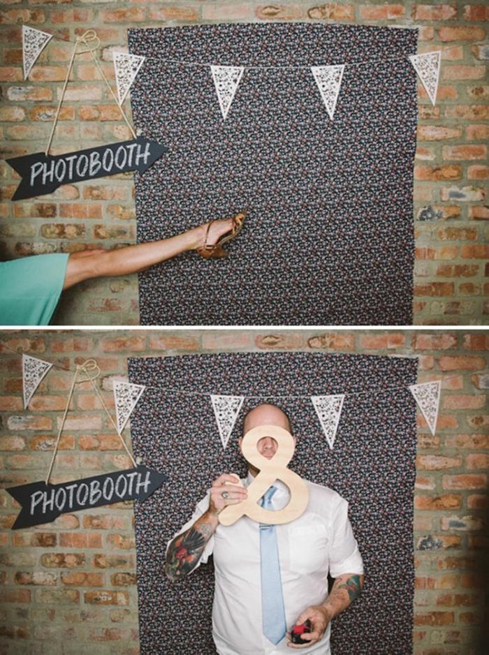 un mur en briques trompe l'œil décoré avec toile de fond photobooth