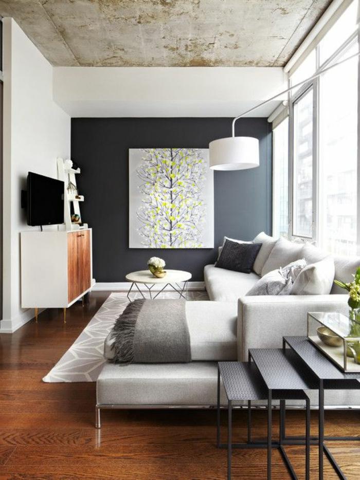 aménager une petite chambre, sofa d'angle, tapis gris, tables noires gigognes
