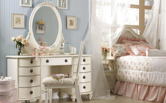 decoration interieur, miroir ovale en blanc, cadres photos rectangulaires, boîtes rose, table de chevet vintage