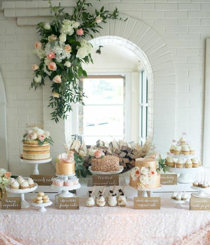 bar à bonbons mariage, nappe rose, cupcakes, gateaux, décoration florale, fleurs, et fond fenêtre et mur blanc, sucette gateau