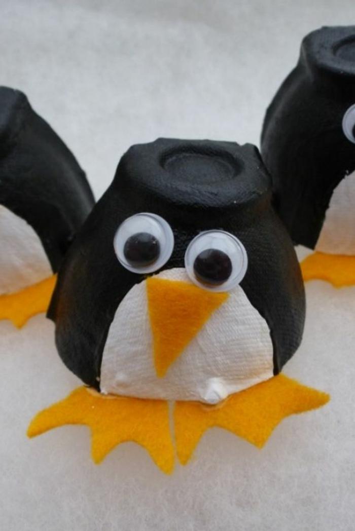 boite a oeuf bricolage, pingouins faits avec du carton et du papier