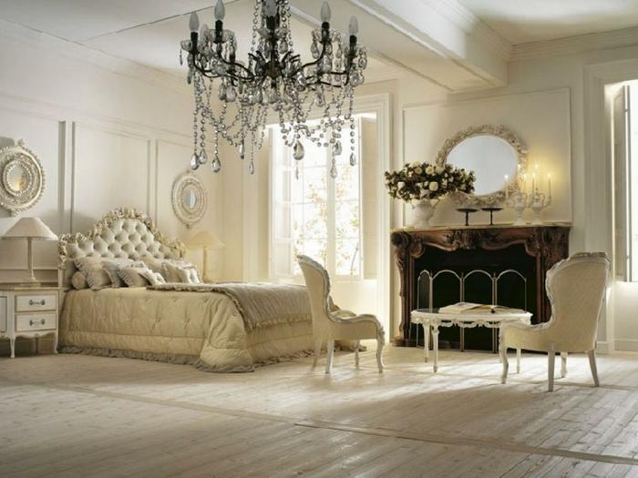 chambre boudoir, murs blanc, tête de lit capitonnée, lampe de chevet blanche, parquet stratifié