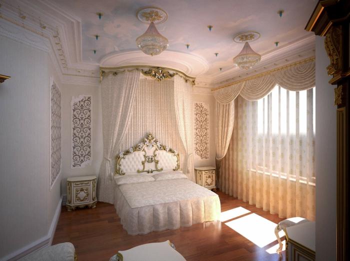 deco campagne chic, table de chevet blanche avec contours dorés, lit à baldaquin, lustre en cristaux