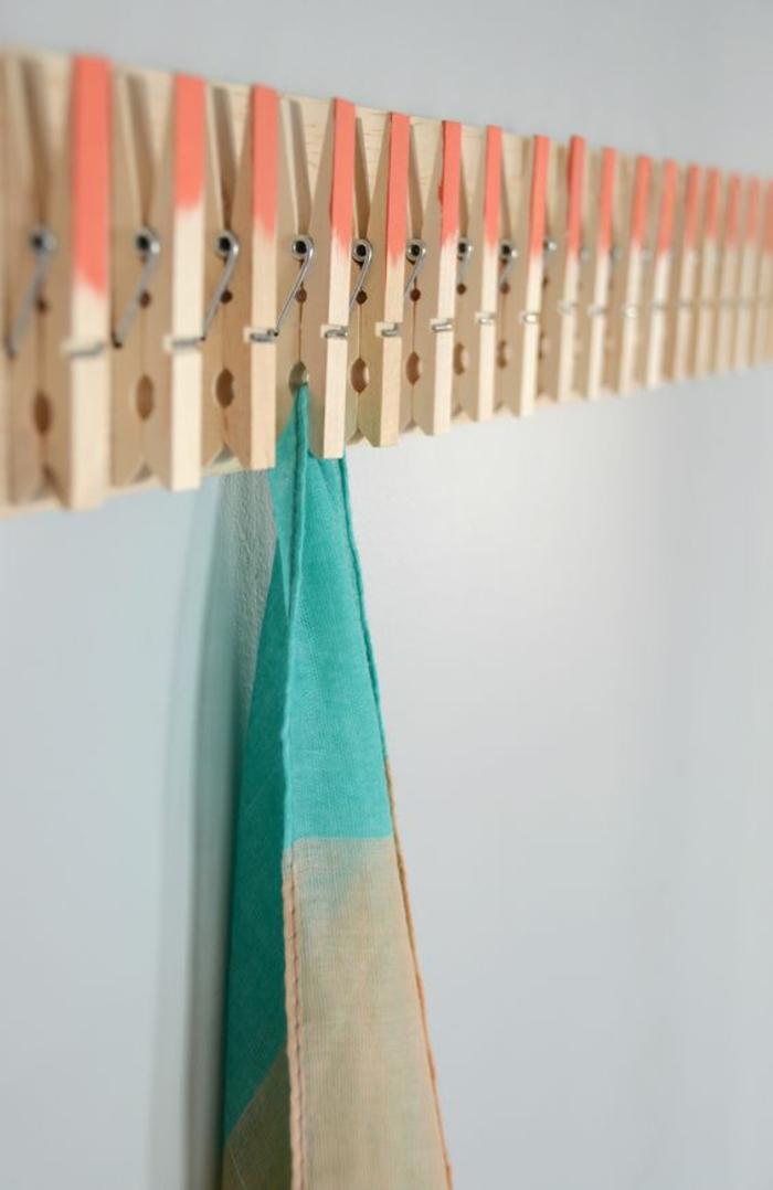 un porte-torchons réalisé avec des pinces à linge en bois ombre, que faire avec des pinces à linges en bois