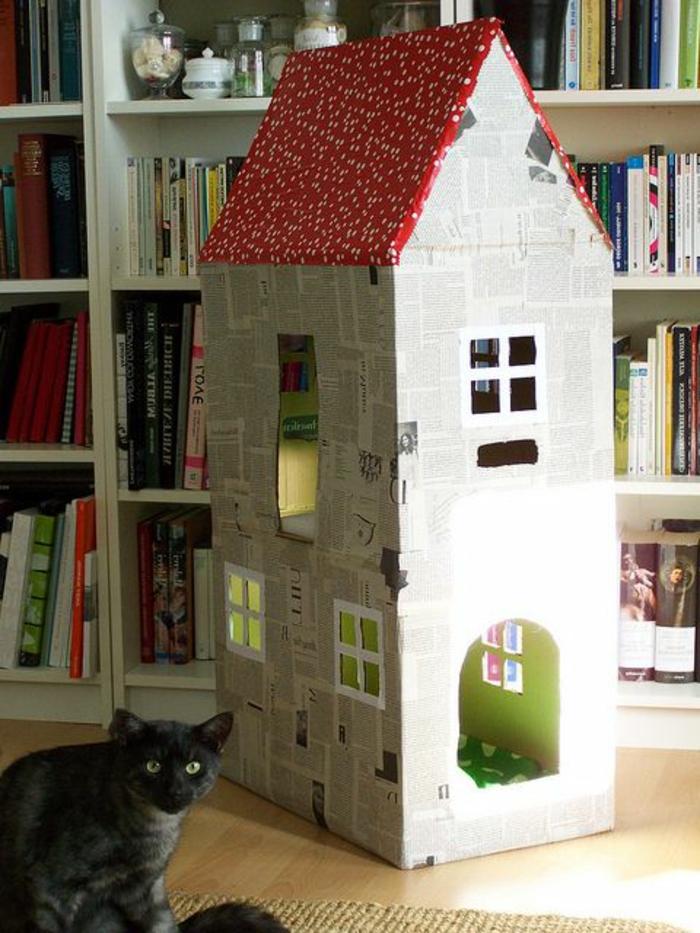 cabane a chat habillée en feuilles de papier et étagère blanche