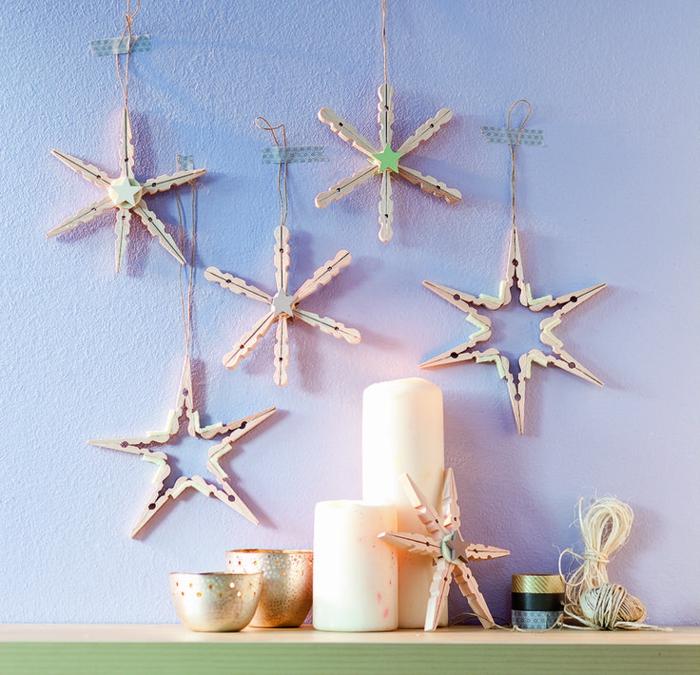 deco recup de noël avec des pinces à linge en bois transformées en jolies étoiles de noël