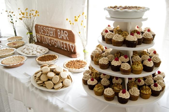 sablés, cupcakes, tartes, deco florale, nappe blanche, fond de décor blanc, planche en bois décorative, candy bar mariage