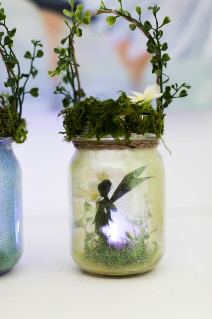 decoration exterieur de jardin, lanterne en bocal de verre, couvercle en verdure, silhouette de fée en papier