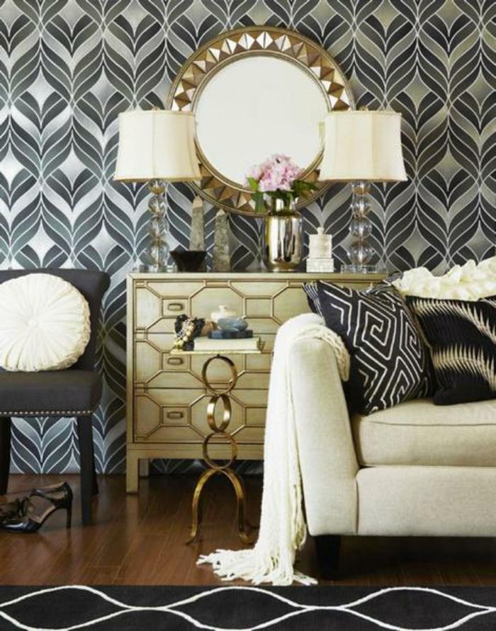 intérieur art déco, commode luxueuse, deux lampes de table, miroir rond, coussins déco