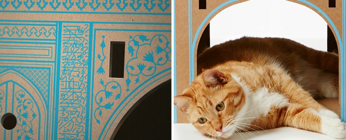 jolie maisonette chat, un chat dormant dans sa maisonette
