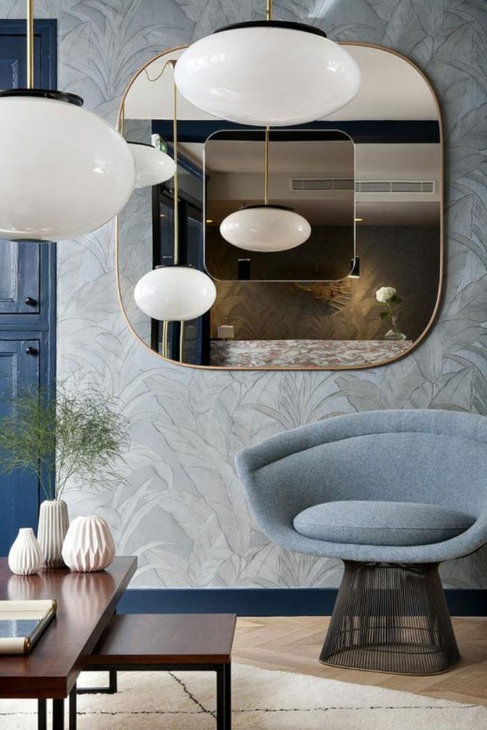 meubles art deco, plafonniers blancs, chaise grise, papie rpeint élégant