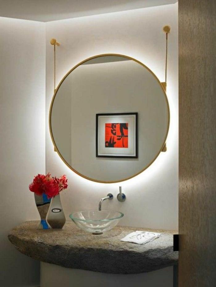 miroir de salle de bain lumineux en forme ronde avec effet pendant du mur