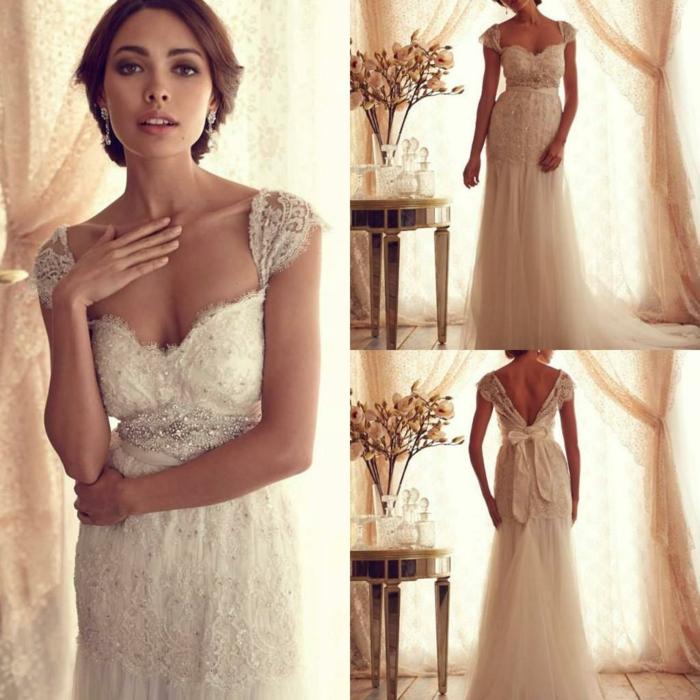 modèle vintage élégant d'une robe mariée dentelle à dos décolleté avec ruban et cap manches