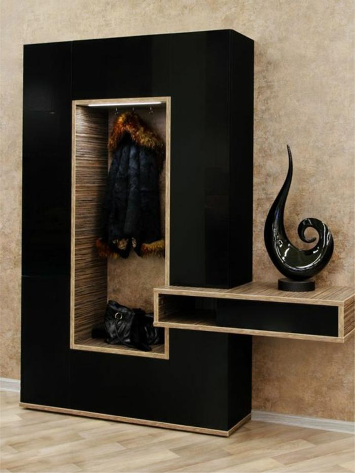 idee deco hall d entree maison avec un meuble en noir et beige carré et une spirale en céramique décorative
