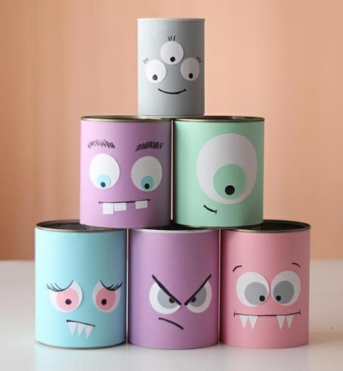 recyclage boite de conserve pour fabriquer des rangements colorés sympas, decoration papier coloré et traits de visage en papier, petits monstres