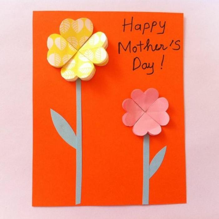carte fête des mères à fabriquer, fleurs à quatre pétales sur une carte orange