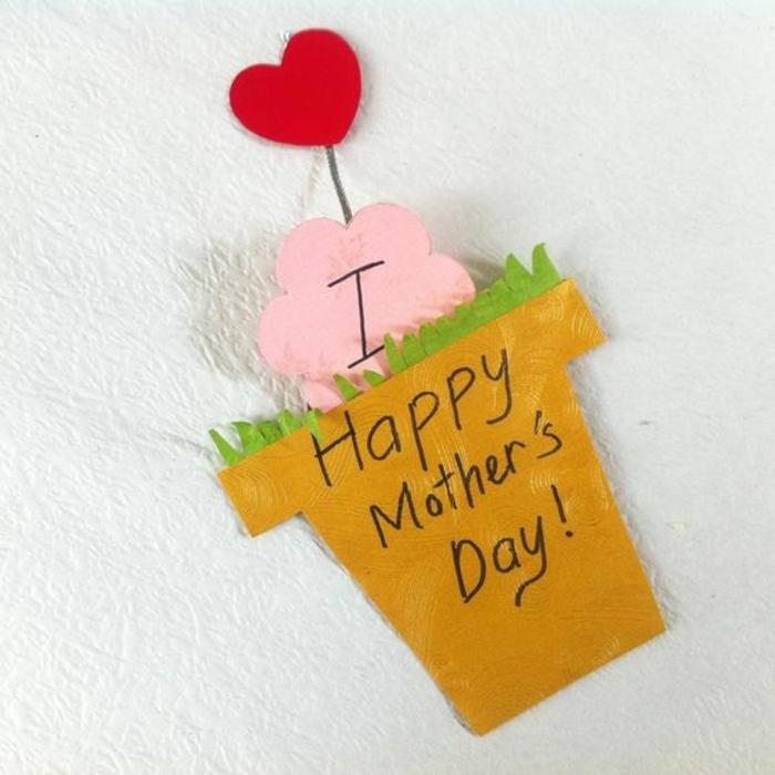 carte fête des mères à fabriquer, pot de fleur jaune en papier avec une nuage rose et un coeur rouge