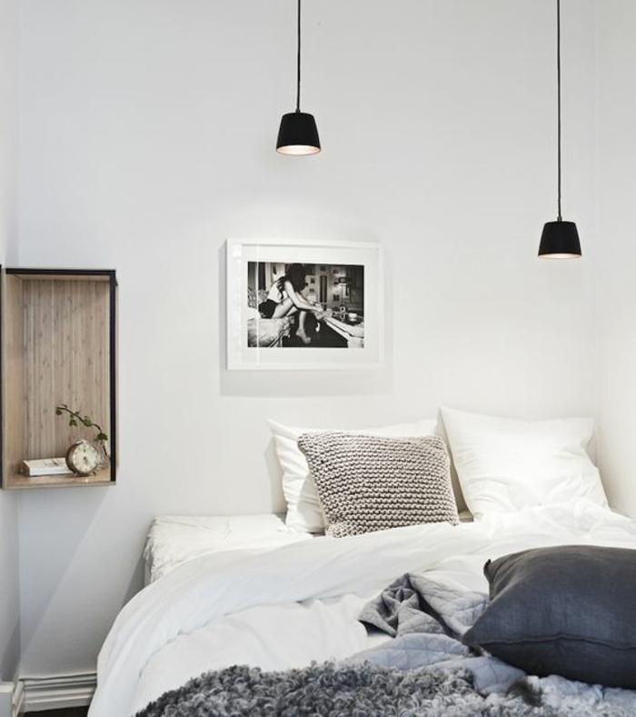 un luminaire suspension noir au style minimaliste, chambre à coucher scandinave à décor chaleureux