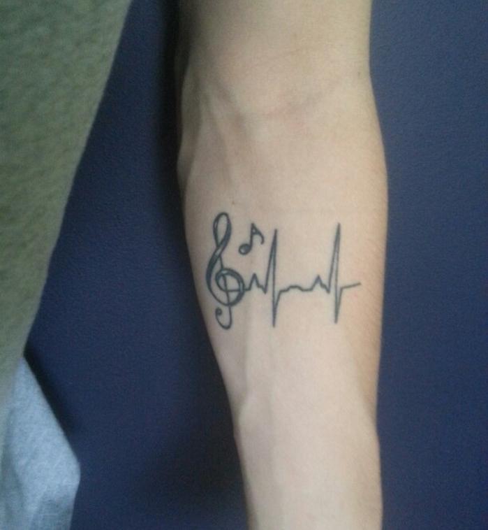 tatouage portée de musique avant bras homme frequences tattoo music