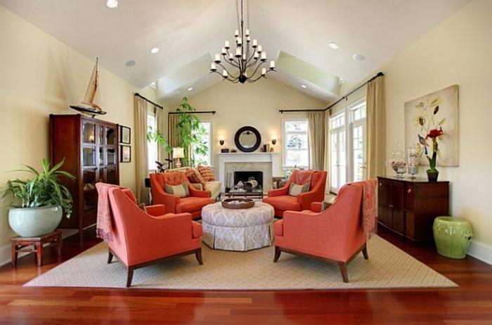 fauteuils couleur corail, salle de séjour élégante, table pouf rond, murs beiges