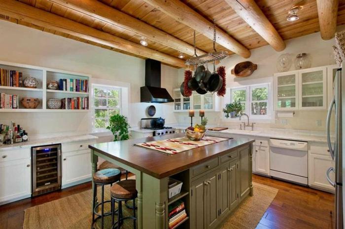 cuisine rustique, étagère murale en bois, livres de cuisine, suspension avec poêles, nappe multicolore, bocaux en verre