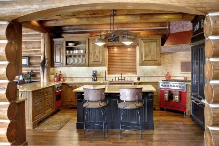 relooker cuisine en bois, îlot central en gris foncé, suspension luminaire en fer forgé, cadre photo noir, four rouge