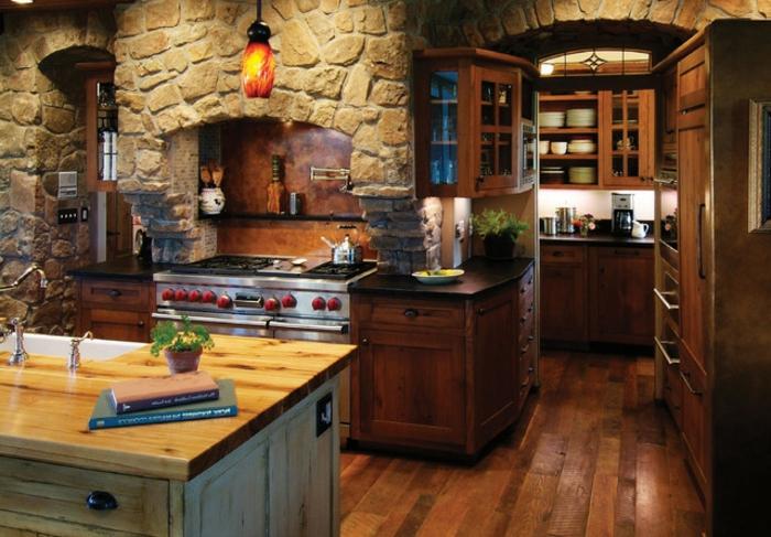 cuisine rustique, îlot centrale en bois, pot à fleur céramique, relooker sa cuisine, livres, murs en pierres, herbes vertes