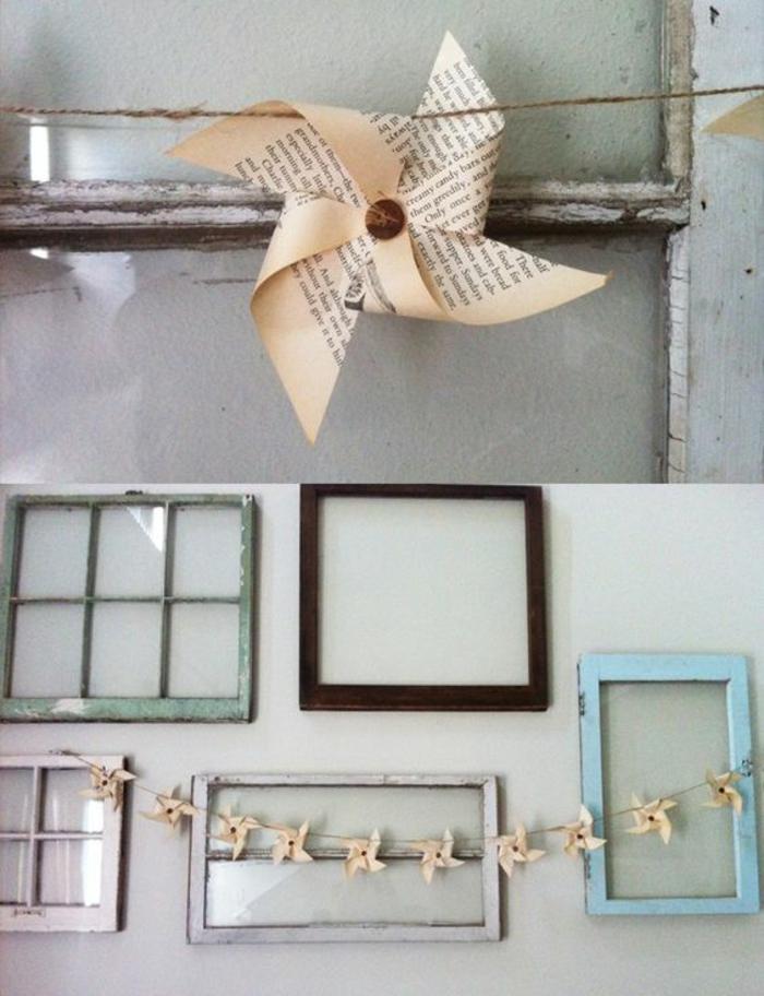 déco récup originale, des anciennes cadres en bois et une guirlande en ficelle de chanvre et à moulin à vent papier journal
