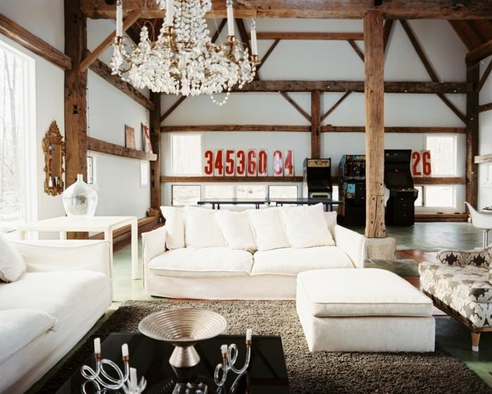 deco campagne chic au charme rustique, lustre élégant, canapé blanc, tapis gris, table gris foncé, poutre apparente, decoration chiffres