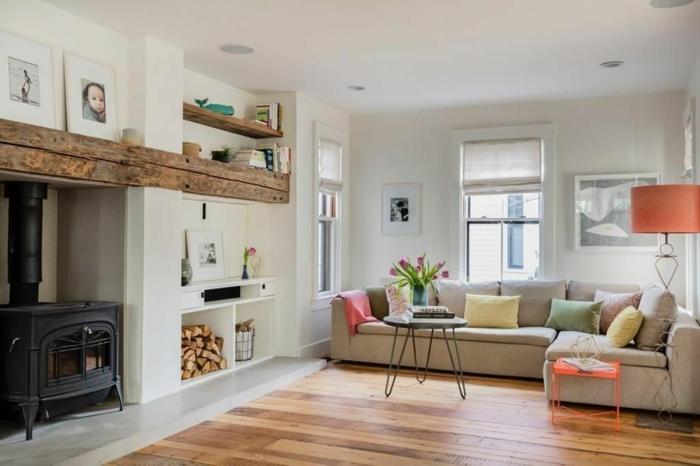 deco campagne chic rustique, parquet en bois clair, table style scandinave, canapé gris clair, cheminée vintage, coussins multicolores