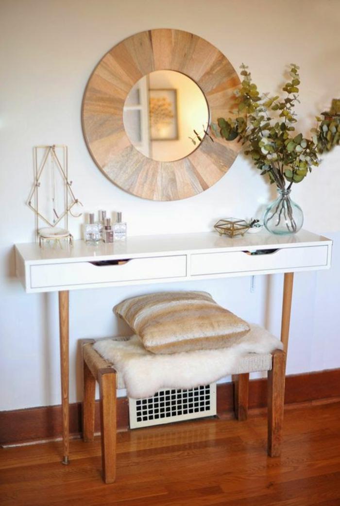 amenagement hall entree avec miroir rond en forme de soleil rayonnant et table haute en bois blanc et marron avec deux tiroirs