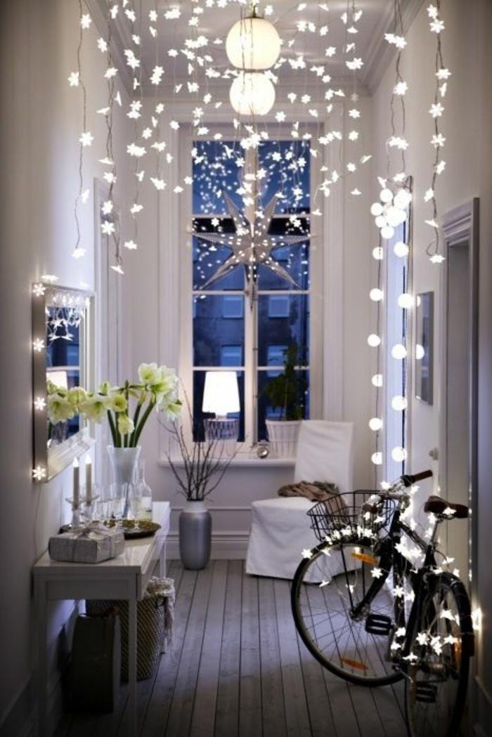 deco hall entree aux multiples ampoules et aux luminaires ronds avec des meubles en blanc