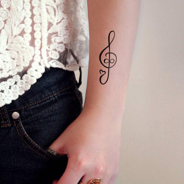 tattoo cle de sol ameliore perso avant bras femme idee