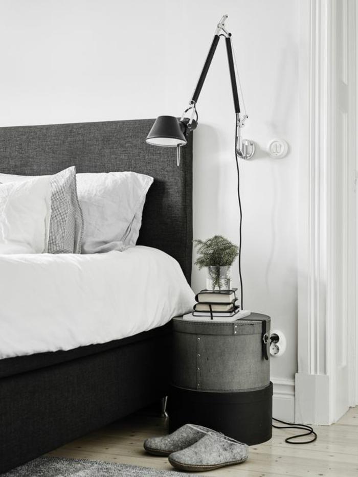 une suspension chevet réglable au design industriel, chambre à coucher monochrome à intérieur masculin
