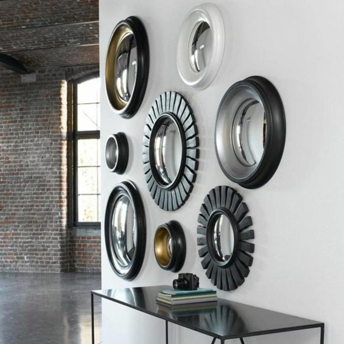 miroir oeil de sorcière plusieurs éléments de taille diverse pour décorer un mur blanc