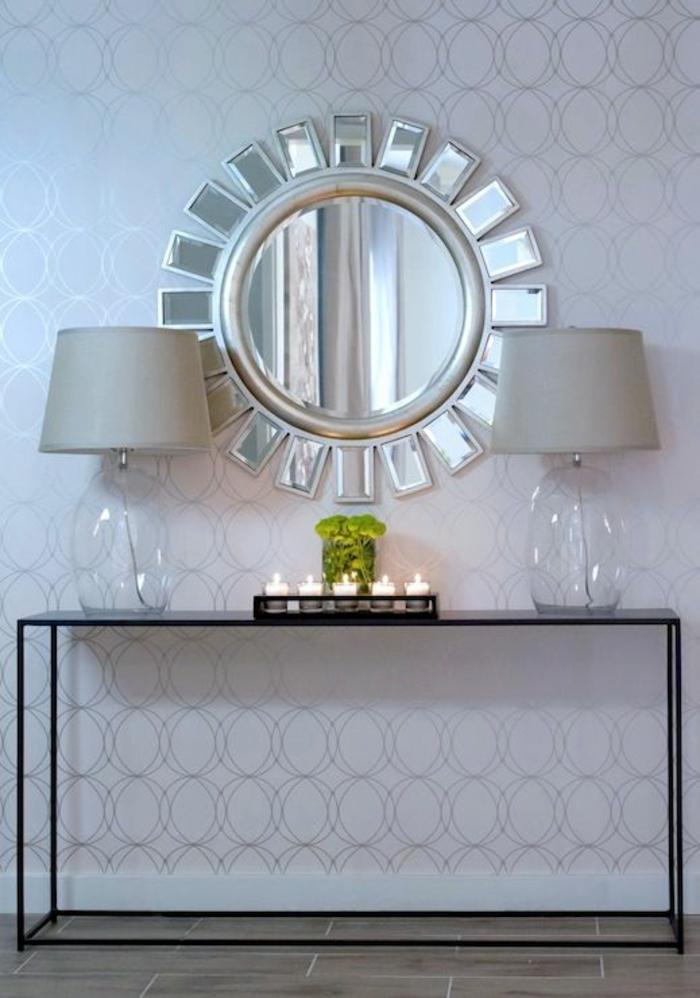 canestrelli venise miroir soleil oeil de sorcière avec deux petits lampadaires de coté sur table moderne en métal en noir