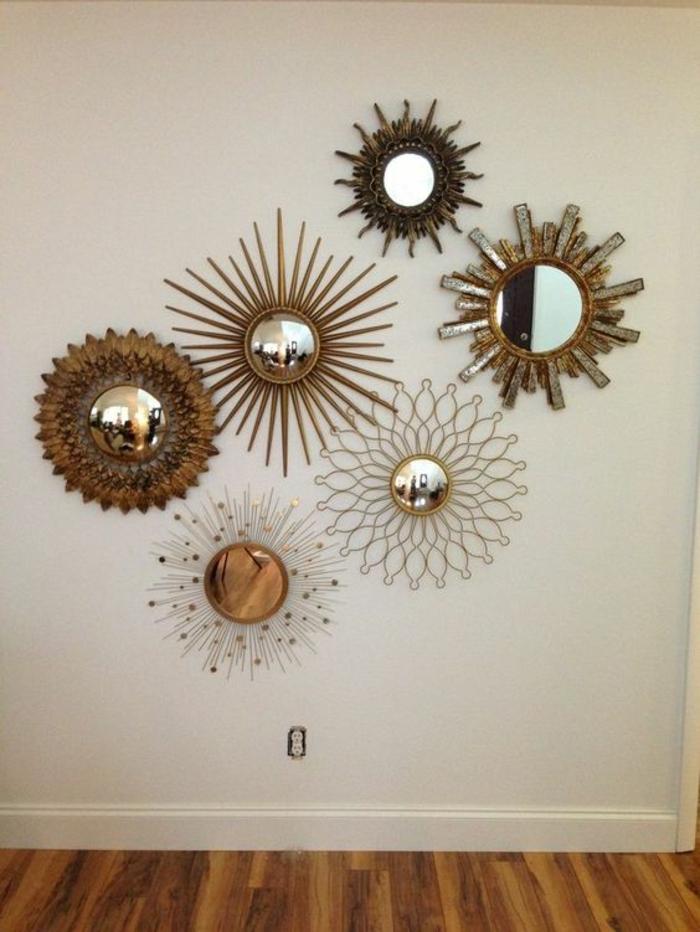 miroir de sorcière définition soleils sur un grand mur blanc