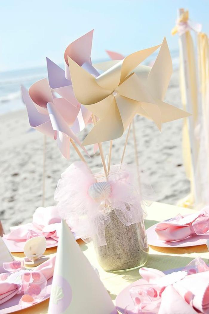 que faire avec un moulin à vent papier, un centre de table pastel décoré de moulins à vent en papier