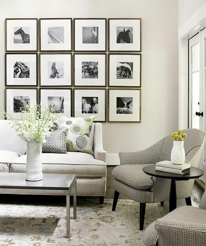 cadre photo original, canapé blanc, fauteuil gris, table ronde noire, grande fenêtre, murs blancs