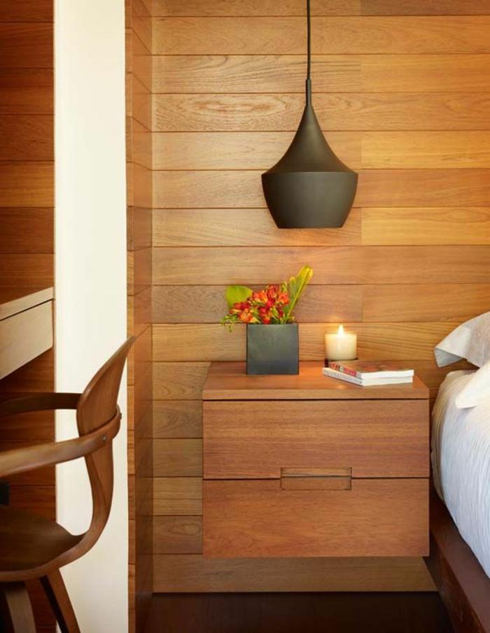 une élégante chambre à coucher à intérieur en bois, un ample luminaire suspension en métal noir