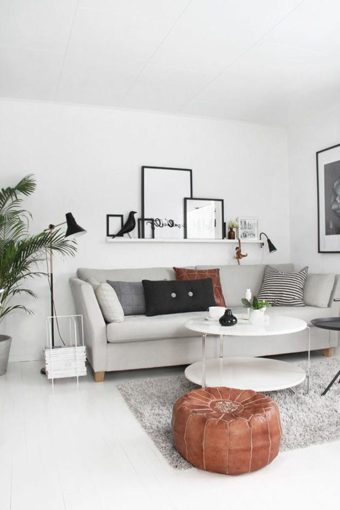quelle couleur avec du gris, étagère blanche, sofa gris, table ronde et peintures monochromes