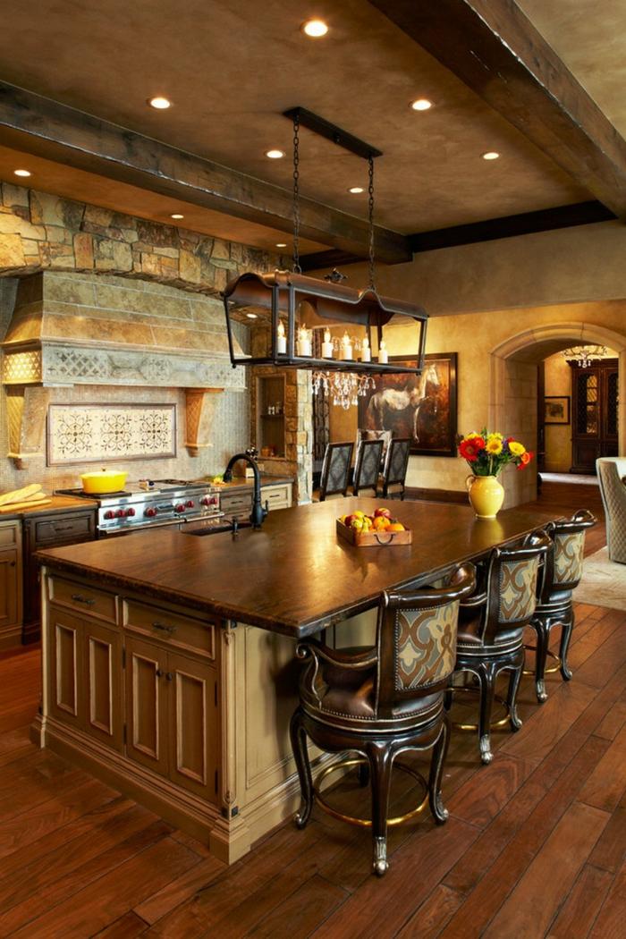 cuisine actuelle, comptoir marron, éclairage led, deco campagne chic, vase orange, relooker cuisine en bois