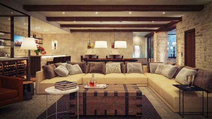 deco contemporaine aux accents campagne chic, tapis marron, canapé d angle fauve, table basse coffre, poutres apparentes, mur en briques, deco vintage oriental