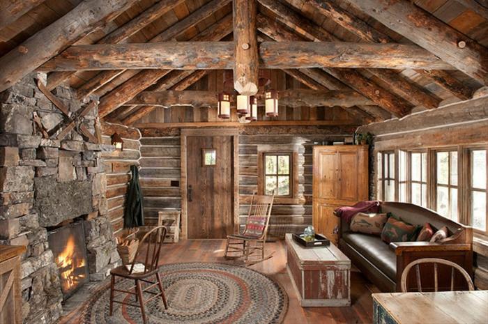 salon rustique, deco chalet, tapis rond, revêtement sol en bois, canapé en cuir, parquet en bois, maison ossature bois, poutre apparente