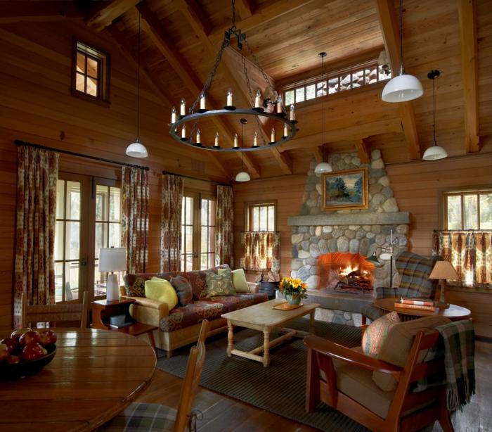 deco contemporaine rustique, canapé, fauteuils et table en bois, cheminée en pierre, tapis gris, maison ossature bois, deco chalet, coin repas