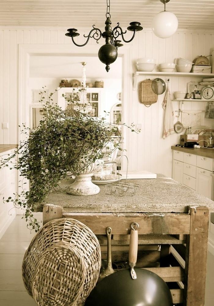 table campagne chic, etageres blanches, ilot central en bois et béton, décoration vaisselle blanche, suspension originale, centre de table floral retro