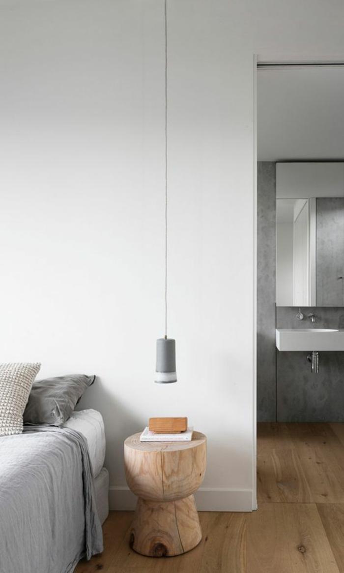 une suspension luminaire basse gris au design délicat, table de chevet monobloc en bois